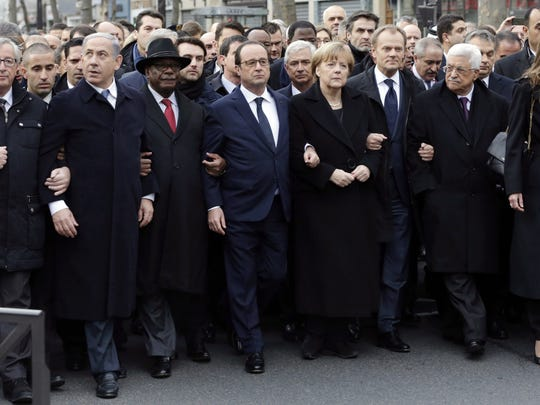 French President Francois Hollande, center, is surrounded by heads of state including (left to right) Israel's Prime Minister Benjamin Netanyahu, Mali's President Ibrahim Boubacar Keita, Germany's Chancellor Angela Merkel, European Council President Donald Tusk and Palestinian President Mahmoud Abbas  as they attend the solidarity march in Paris.