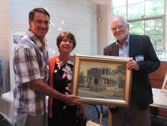 -Photo 1 from left to right Paul and Cindy Lovett receive the original oil p.jpg