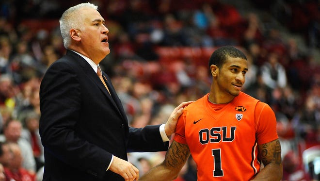 Oregon State Beavers guard Gary Payton II (1) talks with Oregon State Beavers head coach Wayne Tinkle during a game against the Washington State Cougars at Wallis Beasley Performing Arts Coliseum in Pullman, Wash., on Jan. 17. The Beavers won 62-47.