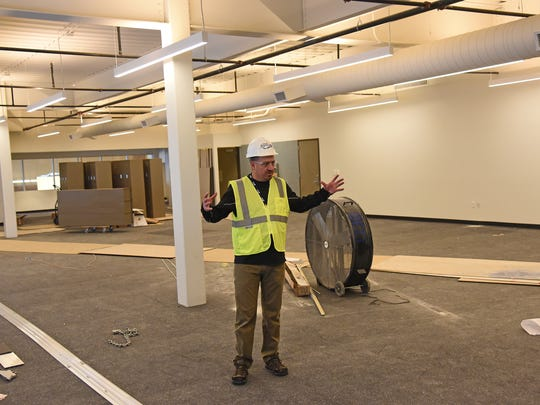 Marc Rademacher, recreation manager for the city of Fort Collins shows off  what will become the fitness center and weight room at the new Foothills Activity Center located at Foothills Mall.