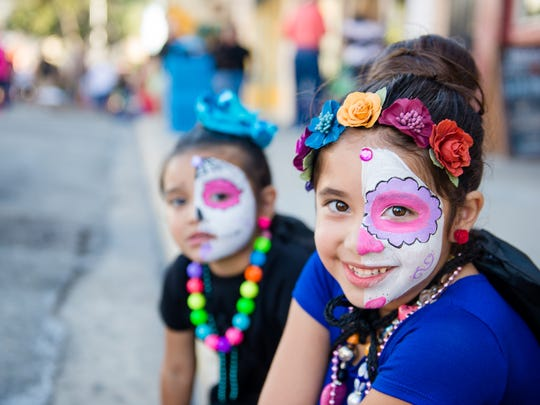 Lyla Saldana, 5, and Layena Perez, 3, had their faces painted as calaveras Saturday, Oct. 29, 2016, during the Día de los Muertos Street Festival in downtown Corpus Christi.