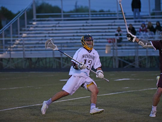 Windsor High School's boys lacrosse team, shown during a playoff game last season, will host Conifer at 7 p.m. Monday night.