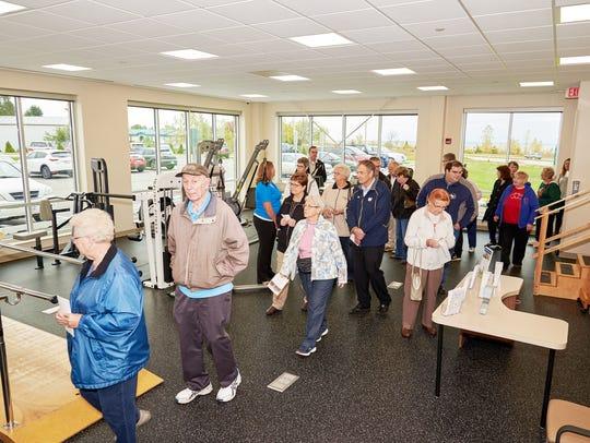 Visitors tour Rehab Plus at the HFM Lakefront Campus