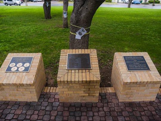Twenty-nine live oak trees and a plaque commemorate