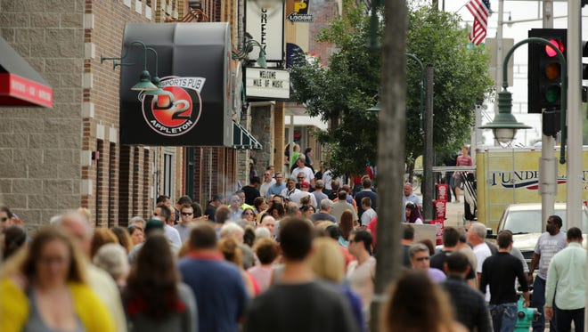 Music fans stream along College Avenue in downtown Appleton during Mile of Music in August, an event community leaders highlight as a draw for young professionals.  Ron Page/USA TODAY NETWORK-Wisconsin