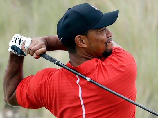 Tiger Woods, shown in this Dec. 4, 2016 file photo, has played golf with both President Barack Obama and President Donald Trump.