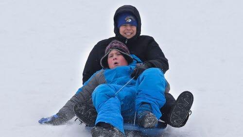 Kim Nicholson, an MPS teacher and her son Grant Nicholson 9, from Milwaukee, enjoy sledding at Whitnall Park.