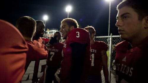 Port Huron senior Tahson Winters (3) smiles after Friday's victory.