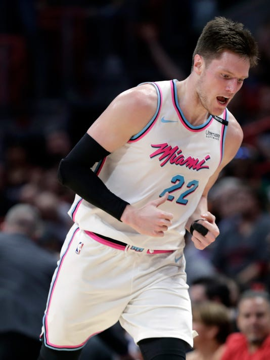 Miami Heat's Luke Babbitt (22) reacts after shooting a three-point basket during the first half of an NBA basketball game against the Phoenix Suns, Monday, March 5, 2018, in Miami. (AP Photo/Lynne Sladky)
