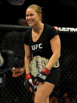 Ronda Rousey celebrates her first-round win over Sara McMann at UFC 170.