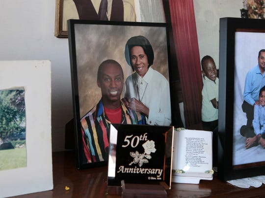 Family photos, including of Vernice Warfield and her son Thomas Warfield (a dancer and artist who runs the National Technical Institute for the Deaf dance program at Rochester Institute of Technology), decorate the mantle in her home.