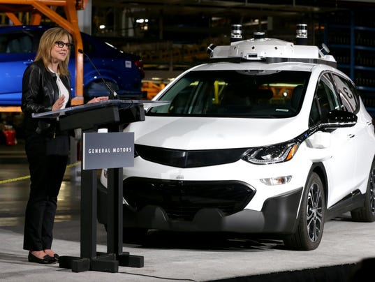 GM CEO Mary-Barra with autonomous Chevrolet Bolt