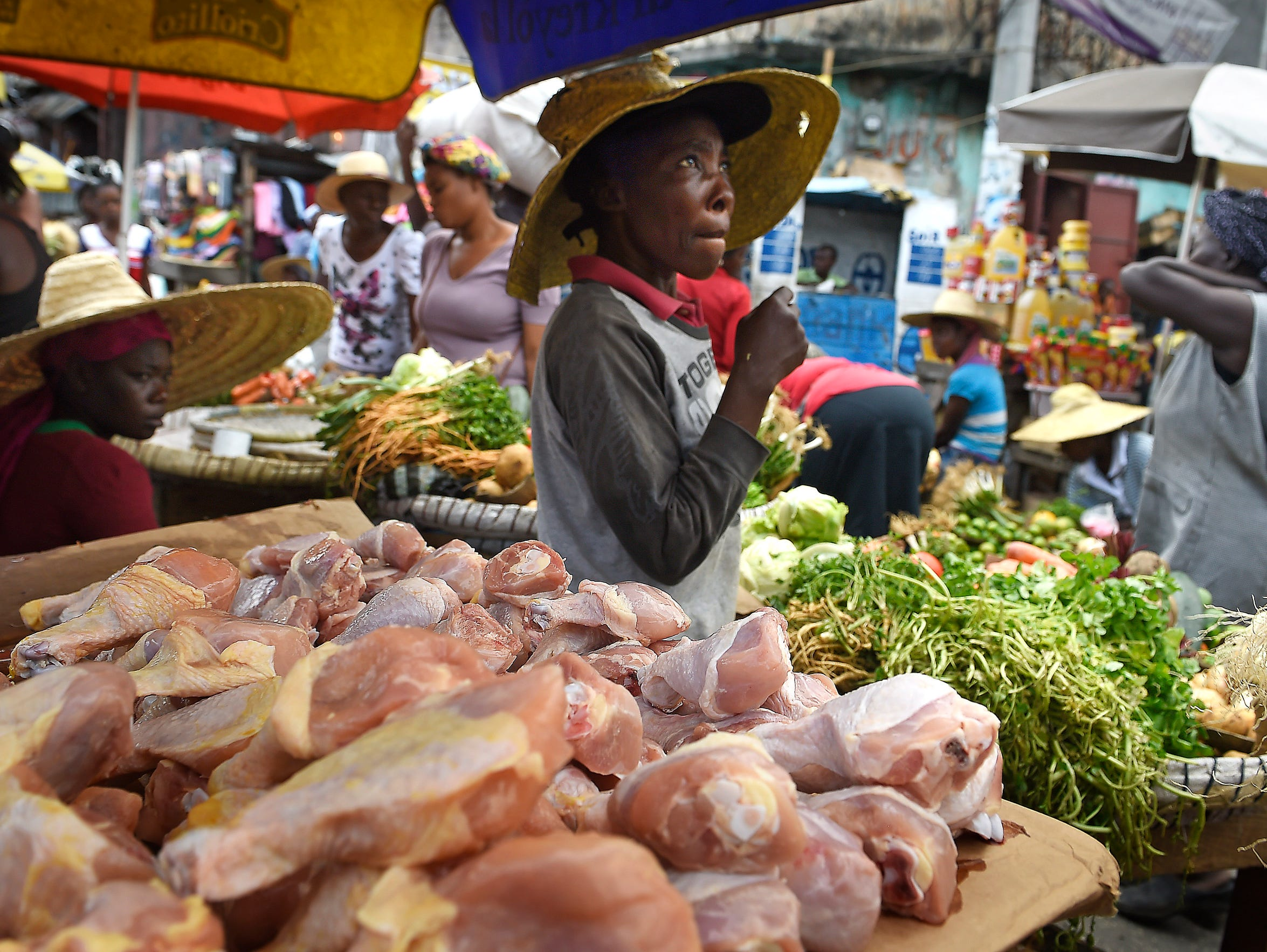 Imported chicken parts are sold in a Port-au-Prince