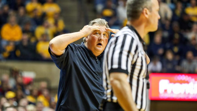 West Virginia Mountaineers head coach Bob Huggins reacts to a call during the second half against the Virginia Cavaliers at WVU Coliseum in Morgantown, W.V.