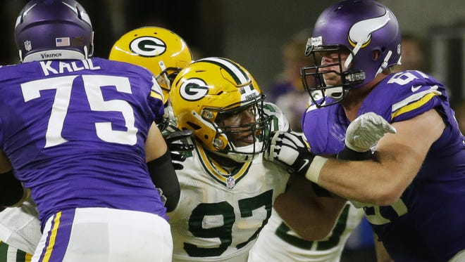 Packers nose tackle Kenny Clark (97) is double-teamed during Green Bay's 17-14 loss to the Vikings at U.S. Bank Stadium in September.