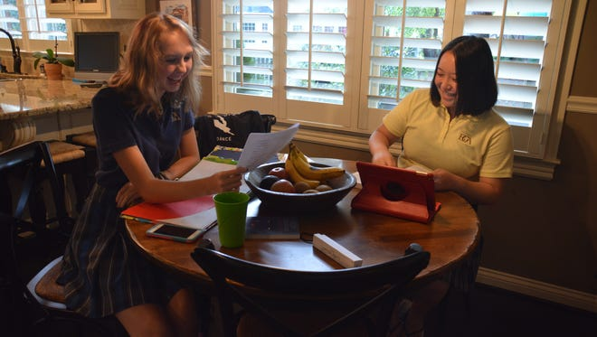 """Battle Ground Academy juniors Anna Claire Evans, left, and Fangle """"Annie"""" Zhao work on homework. Zhao is from China."""