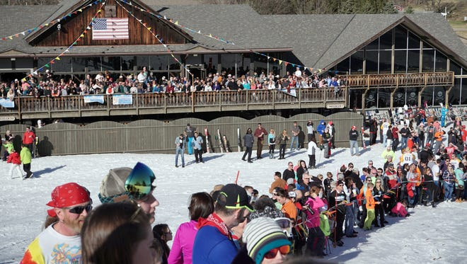 Spectators watch the Chippendale and Bikini Race during the 2016 Ski Carnival at Snow Trails.
