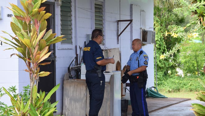 Guam Police Department officers investigate a possible home invasion along Chalan Goro Elena in Yigo on July 12, 2017.