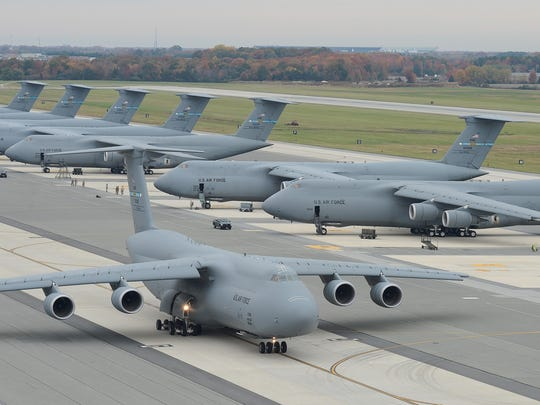 A C-5M Super Galaxy aircraft taxis at Dover Air Force Base.