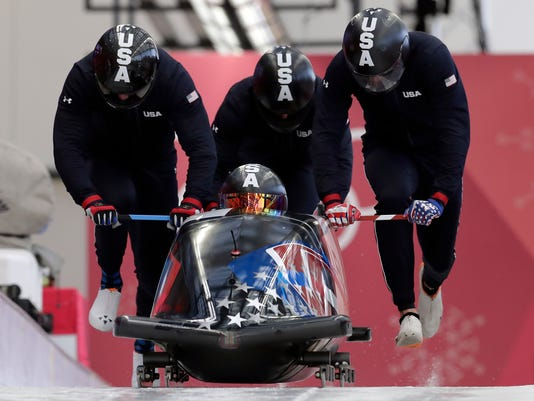 Driver Codie Bascue, Steven Langton, Samuel Mc Guffie and Evan Weinstock of the United States start a training run for the four-man bobsled competition at the 2018 Winter Olympics in Pyeongchang, South Korea, Wednesday, Feb. 21, 2018. (AP Photo/Michael Sohn)