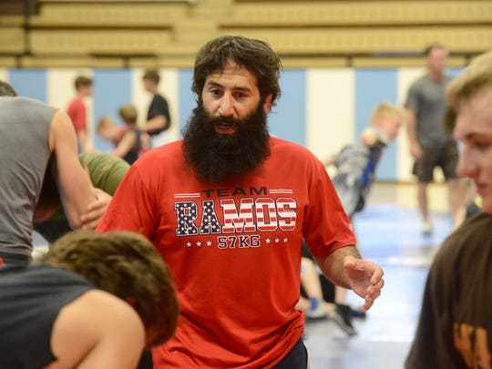 Mike Zadick provides instruction to campers during the Zadick Brothers' Wrestling Camp on Monday afternoon at Great Falls High.