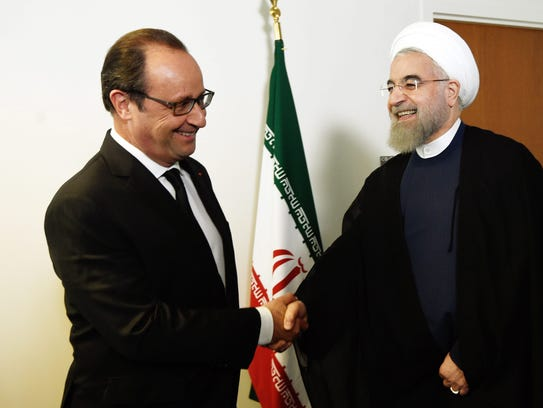 French President Francois Hollande welcomes his Iranian