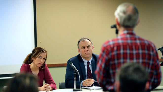 State Rep. Amanda Stuck, D-Appleton, left, and state Rep. Gordon Hintz, D-Oshkosh, listen to Ron Winter of Fox Crossing as he poses a question during a public forum hosted by state Democrats to discuss the Foxconn development Wednesday at the Menasha Public Library.