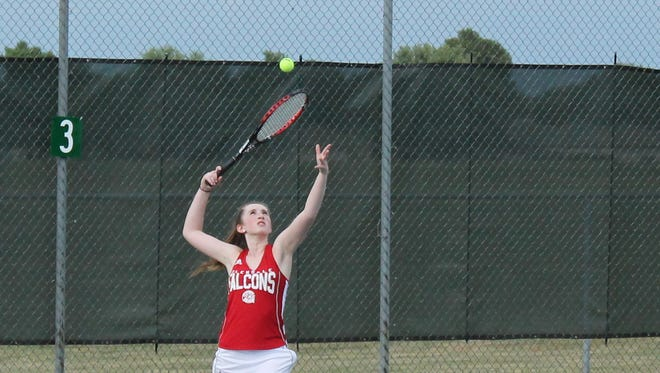Glendale's Rachel Dwyer serves during a match against Greenwood Sept. 8 at the Cooper Tennis Complex