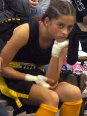 Kayley Lovelace, 11, anxiously waits for her turn in