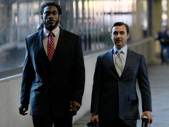 Former Tennessee player A.J. Johnson heads to court with his attorney, Stephen Ross Johnson, on Friday, Nov. 17, 2017, at the City-County Building.