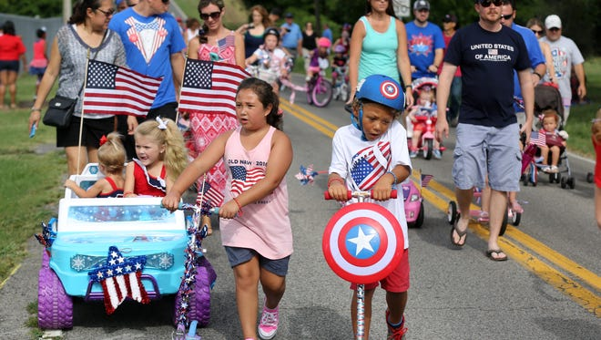 Families participate in Spring Hill's Independence Day bike parade.