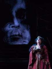 Driscoll Otto's projections loomed over key scenes, such as this with Queen Gertrude (Lara Tillotson) coming to term with the truth in OperaDelaware's 2016 Opera Festival's 'Amleto' (Hamlet).
