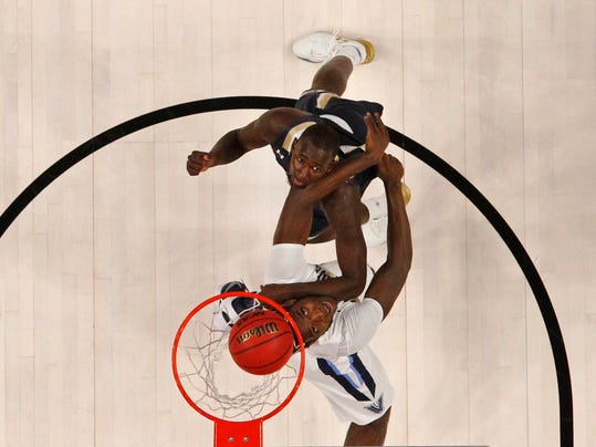 Villanova forward Eric Paschall (4) and Mount St. Mary forward Mawdo Sallah (1) fight for position under the basket during the first half of a first-round men's college basketball game in the NCAA Tournament, Thursday, March 16, 2017, in Buffalo, N.Y. (AP Photo/Jeffrey T. Barnes)