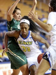 Delaware forward Nicole Enabosi drives past William and Mary's Kasey Curtis in the first half at the Bob Carpenter Center Tuesday.