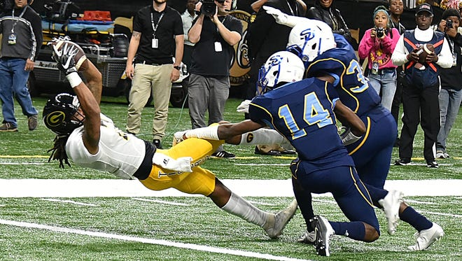 A Grambling player makes a catch against Southern.