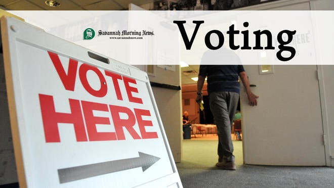 Richard Burkhart/Savannah Morning NewsA voter enters the polling room Tuesday afternoon at the JEA.