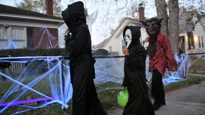Richard Burkhart/Savannah Morning NewsTrick-or Treaters make their way through the Parkside neighborhood Halloween night on east 49th street.