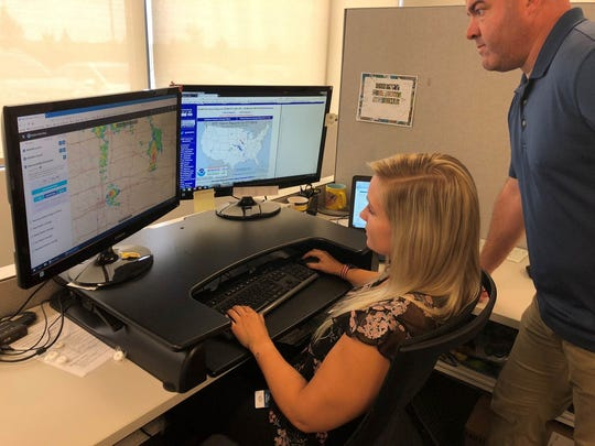 EagleView Storm Response Team members Trisha Van Buren and Kyle McLaughlin track and monitor weather data for staging of airplanes.