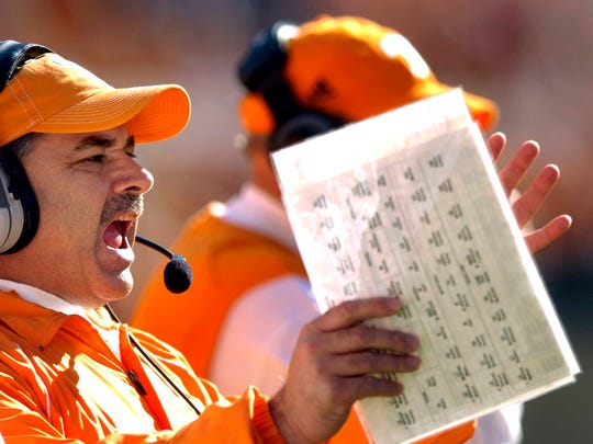 Former Tennessee defensive coordinator John Chavis, shown in 2006, helped the Vols win a national championship in 1998. Fans hope new head coach Jeremy Pruitt can work some similar magic.