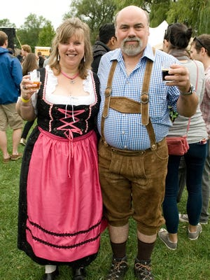 Annette and Frank White of Lansing show off Oktoberfest outfits that they bought in Germany. They were sampling from 45 local, regional, and international breweries at the fourth annual Ithaca Brew Fest.