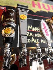 The taps at the Farmington HUB, Brewery and Grill are pictured behind the bar.