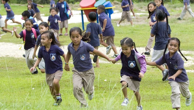 In this file photo, students run back from the playground during recess at J.Q. San Miguel Elementary School.
