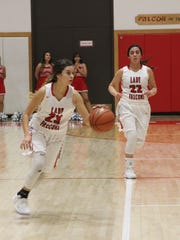 Sophomore Taryn Chacon and senior Alyssa Carrasco run down the court on offense against Tatum Coyotes Friday, Jan. 11, 2018.