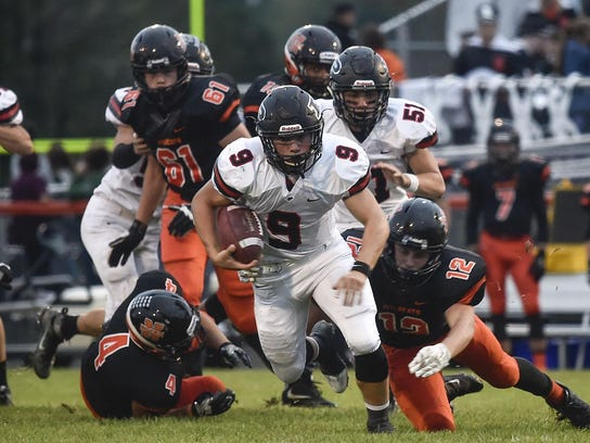 Pleasant running back and linebacker Matt Chase, shown in a 2016 file photo at North Union, was named Division V Central District Defensive Player of the Year. He choked on a piece of meat during a team meal last week and was helped by teammate Carter Wolf who applied the Heimlich maneuver.