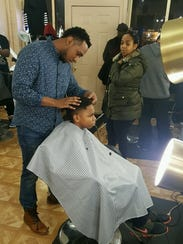 Laced Barber Lounge owner Vince Ross participates in