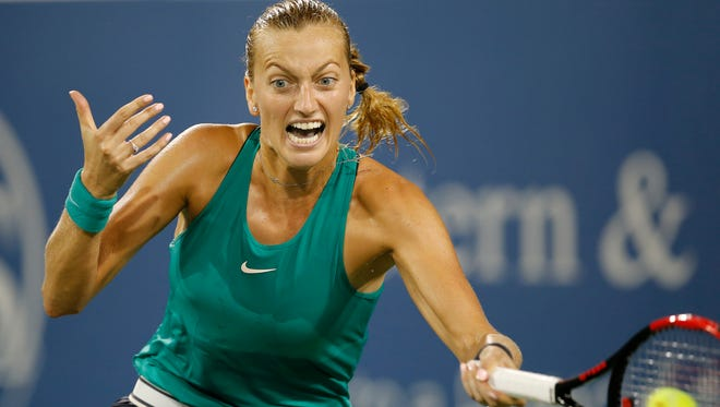 Petra Kvitova returns a shot in the match between Serena Williams and Petra Kvitova in the second round of the Western & Southern Open at the Lindner Family Tennis Center in Mason, Ohio, on Tuesday, Aug. 14, 2018. Williams was eliminated by the 8-seeded Kvitova, 6-3, 2-6, 6-3.