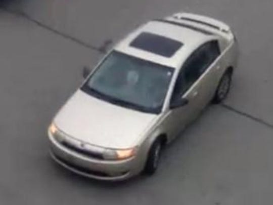 The suspect was possibly driving a gold, four-door Saturn sedan.