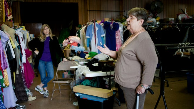Susan Schramm talks about her hopes for finding a new home for the West Deptford Little Theater's props and costumes as Laura Trace looks on, Wednesday, September 24, 2014.