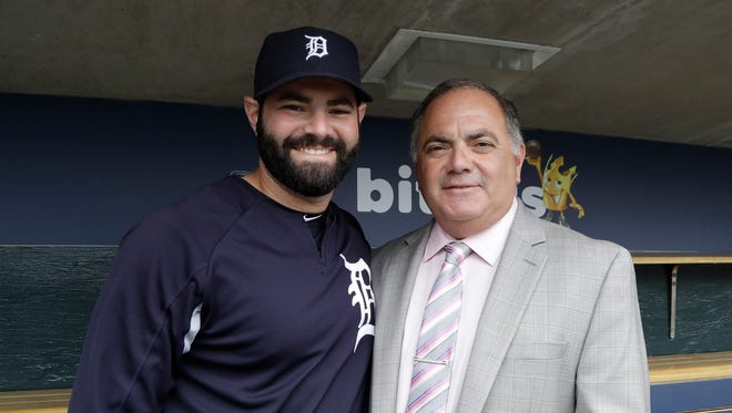 Tigers catcher Alex Avila, left, stands with his father, the team's general manager Al Avila, after an interview in the dugout at Comerica Park on May 19, 2017