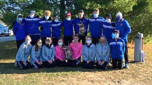 The Saugatuck boys and girls cross country teams won the Division 4 regional championship.